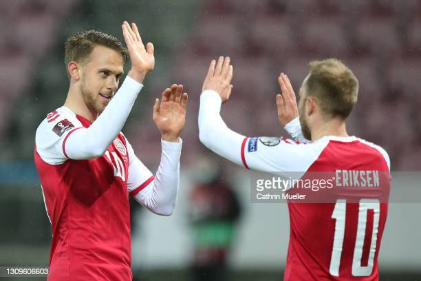 Marcus Ingvartsen of Denmark celebrates with team mate Christian Eriksen after scoring their side's eighth goal during the FIFA World Cup 2022 Qatar...