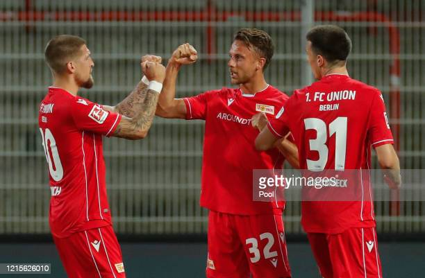 Marcus Ingvartsen of FC Union Berlin celebrates scoring his side's first goal with teammates during the Bundesliga match between 1 FC Union Berlin...