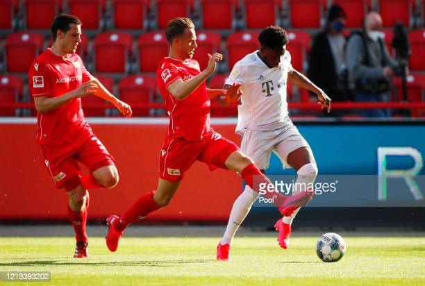 Marcus Ingvartsen of Union Berlin in action with Alphonso Davies of Bayern Munich during the Bundesliga match between 1 FC Union Berlin and FC Bayern...