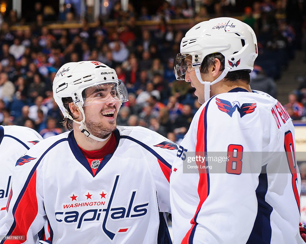 Marcus Johansson #90 and Alex Ovechkin #8 of the Washington Capitals confer between play against the Edmonton Oilers during an NHL game at Rexall Place on October 24, 2013 in Edmonton, Alberta, Canada. The Capitals defeated the Oilers 4-1.