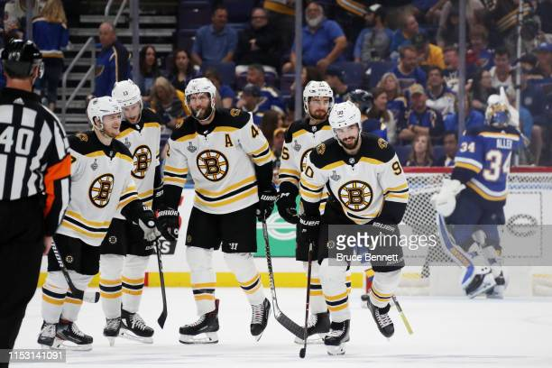 Marcus Johansson of the Boston Bruins celebrates his third period goal with his teammates against the St Louis Blues in Game Three of the 2019 NHL...
