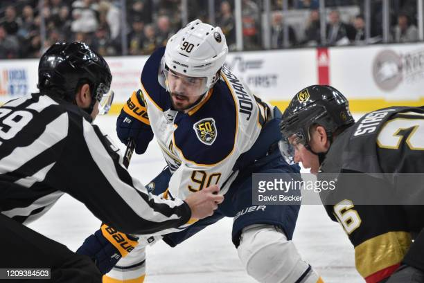 Marcus Johansson of the Buffalo Sabres faces off with Paul Stastny of the Vegas Golden Knights during the second period at TMobile Arena on February...