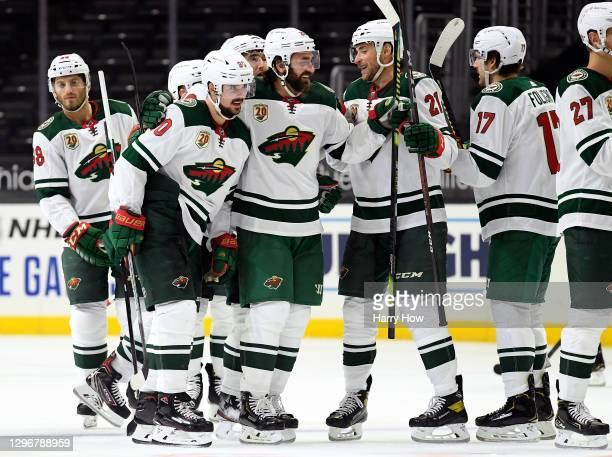 Marcus Johansson of the Minnesota Wild celebrates his game winning goal with Greg Pateryn and Carson Soucy during a 4-3 overtime win over the Los...