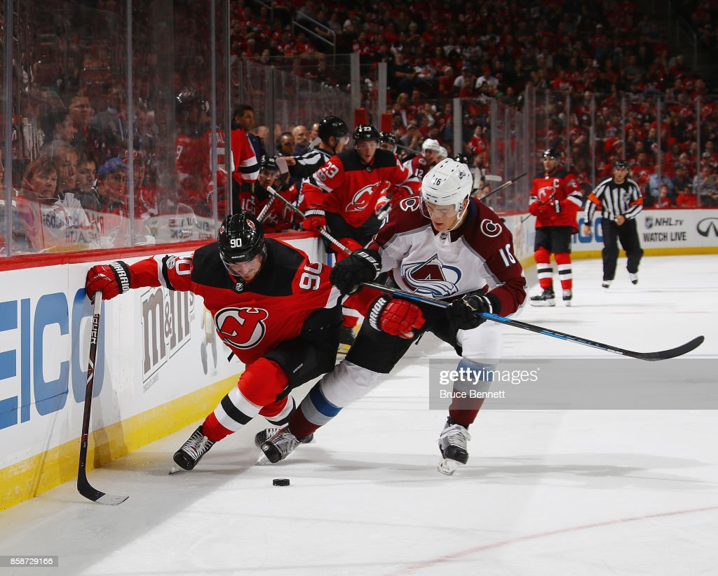 Marcus Johansson #90 of the New Jersey Devils attempts to get around Nikita Zadorov #16 of the Colorado Avalanche during the second period at the Prudential Center on October 7, 2017 in Newark, New Jersey.