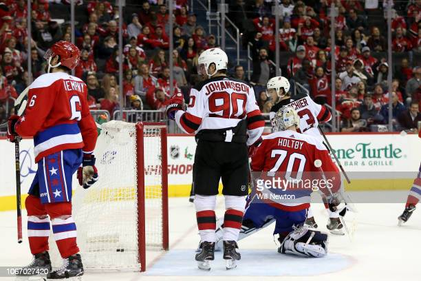 Marcus Johansson of the New Jersey Devils celebrates after scoring against Braden Holtby of the Washington Capitals during the third period at...