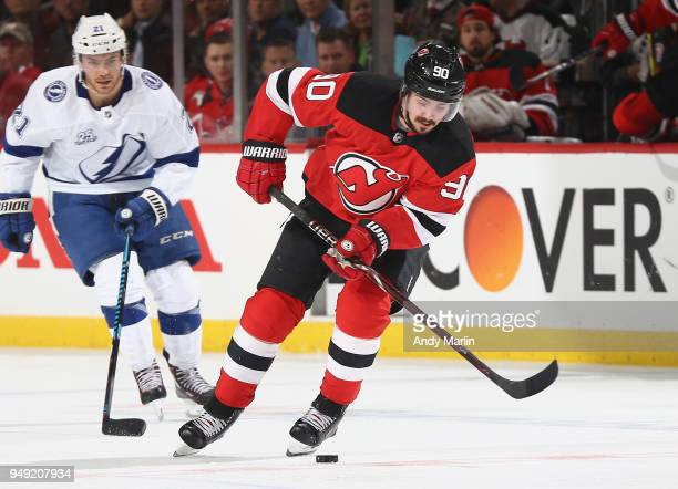 Marcus Johansson of the New Jersey Devils controls the puck in Game Four of the Eastern Conference First Round against the Tampa Bay Lightning during...