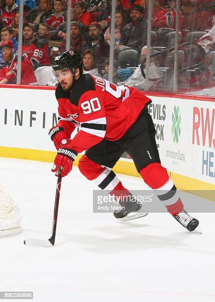 Marcus Johansson of the New Jersey Devils plays the puck against the Columbus Blue Jackets during the game at Prudential Center on December 8 2017 in...