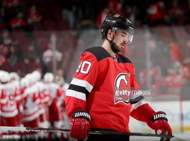 Marcus Johansson of the New Jersey Devils skates off the ice as the Detroit Red Wings celebrate the 30 win over the Devils after the game on January...