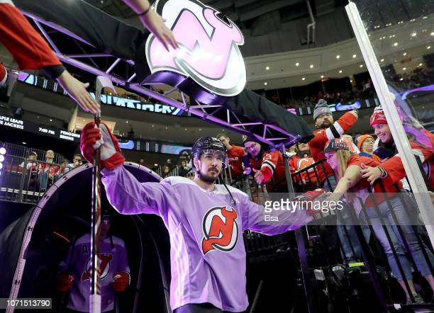 Marcus Johansson of the New Jersey Devils takes the ice for warmups before the game against the New York Islanders at Prudential Center on November...