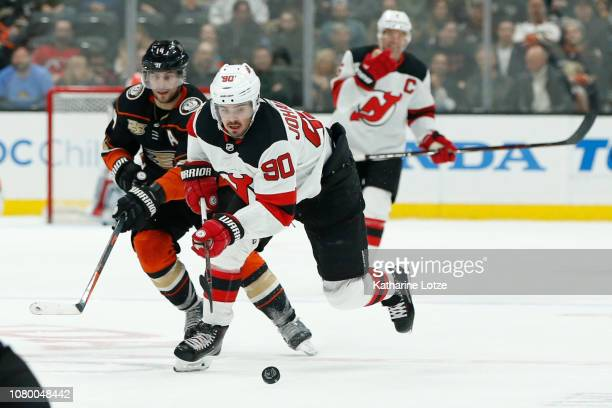Marcus Johansson of the New Jersey Devils takes the puck down the ice against the Anaheim Ducks at Honda Center on December 09 2018 in Anaheim...