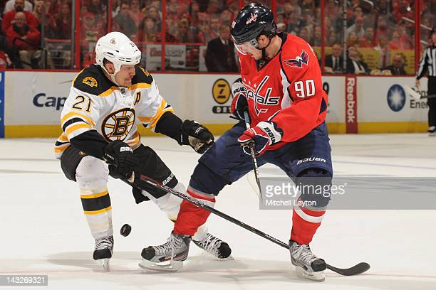 493c5fbbb73 Marcus Johansson of the Washington Capitals and Andrew Ference of the Boston  Bruins fight for the