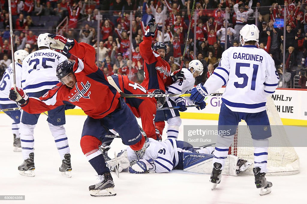 Marcus Johansson #90 of the Washington Capitals celebrates after a goal by John Carlson #74 of the Washington Capitals on Frederik Andersen #31 of the Toronto Maple Leafs in the third period at Verizon Center on January 3, 2017 in Washington, DC.