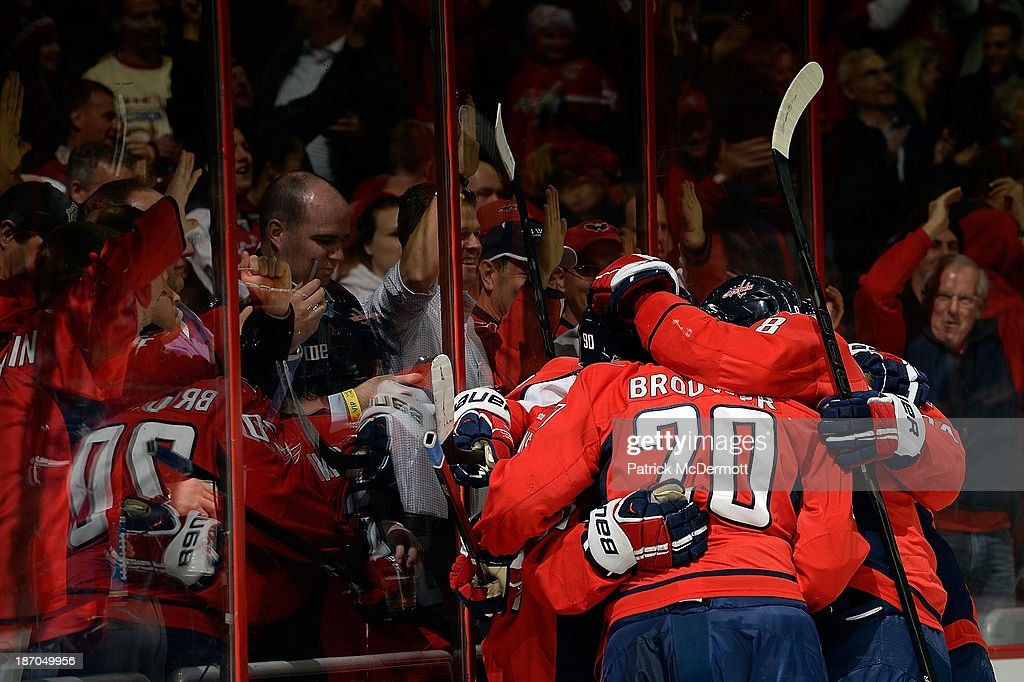 Marcus Johansson #90 of the Washington Capitals celebrates with his teammates after scoring a goal in the second period of an NHL game against the New York Islanders at Verizon Center on November 5, 2013 in Washington, DC.