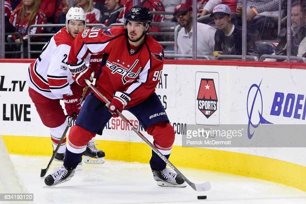 Marcus Johansson of the Washington Capitals controls the puck against Brett Pesce of the Carolina Hurricanes in the third period during an NHL game...