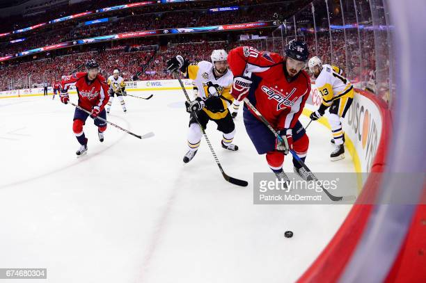 Marcus Johansson of the Washington Capitals controls the puck against Brian Dumoulin of the Pittsburgh Penguins during the first period in Game One...