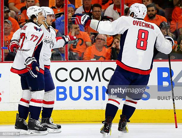 Marcus Johansson of the Washington Capitals is congratulated by teammates TJ Oshie and Alex Ovechkin after Johansson scored in the first period...