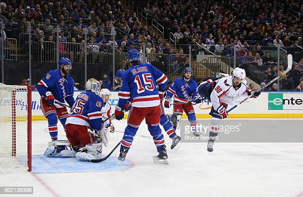 Marcus Johansson of the Washington Capitals is tripped up as he scores at 436 of the third period against Magnus Hellberg of the New York Rangers at...