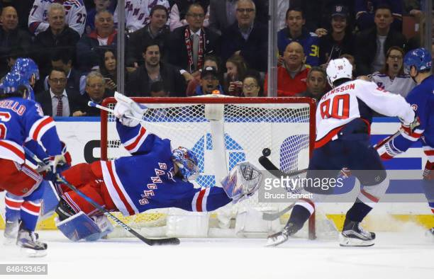 Marcus Johansson of the Washington Capitals scores at 728 of the second period against Henrik Lundqvist of the New York Rangers at Madison Square...