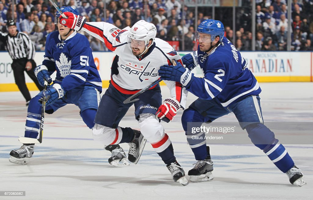 Marcus Johansson #90 of the Washington Capitals skates between Jake Gardiner #51 and Matt Hunwick #2 of the Toronto Maple Leafs in Game Six of the Eastern Conference Quarterfinals during the 2017 NHL Stanley Cup Playoffs at the Air Canada Centre on April 23, 2017 in Toronto, Ontario, Canada. The Capitals defeated the Maple Leafs 2-1 in overtime to win series 4-2.