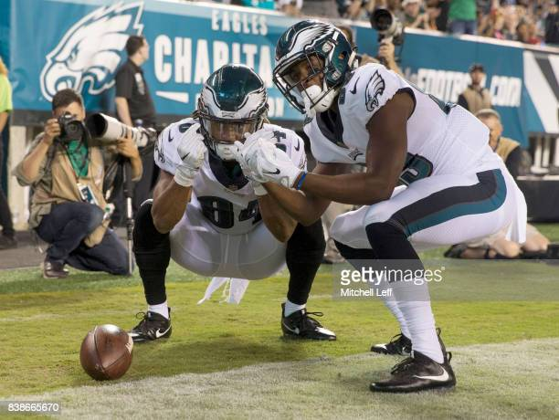 Marcus Johnson and Greg Ward Jr. #89 of the Philadelphia Eagles celebrate after a touchdown by Johnson in the fourth quarter against the Miami...