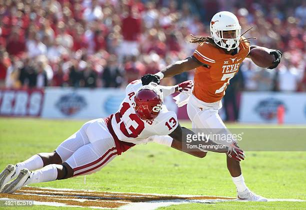 Marcus Johnson of the Texas Longhorns scores a touchdown against Ahmad Thomas of the Oklahoma Sooners in the first quarter during the ATT Red River...