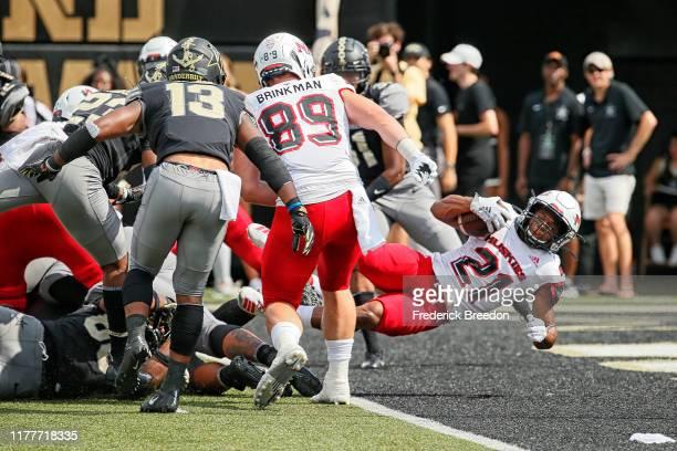 Marcus Jones of the Northern Illinois Huskies scores a touchdown against the Vanderbilt Commodores during the second half at Vanderbilt Stadium on...