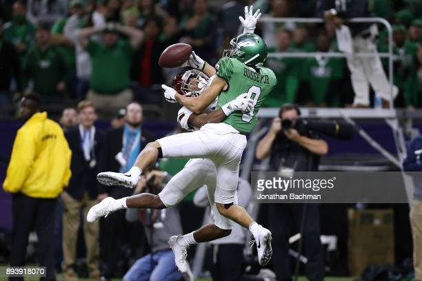 Marcus Jones of the Troy Trojans breaks up a pass intended for Rico Bussey Jr #8 of the North Texas Mean Green during the first half of the RL...