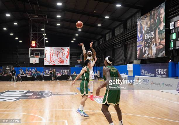 Marcus Keene of Yulon Luxgen Dinos attempt 3 point shot during the SBL Finals Game Six between Taiwan Beer and Yulon Luxgen Dinos at Hao Yu Trainning...