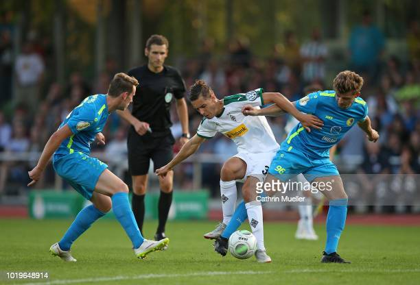 Marcus Kenneweg of BSC Hastedt Florian Neuhaus of Borussia Moenchengladbach and Haris Lakic of BSC Hastedt battle for the ball during the DFB Cup...