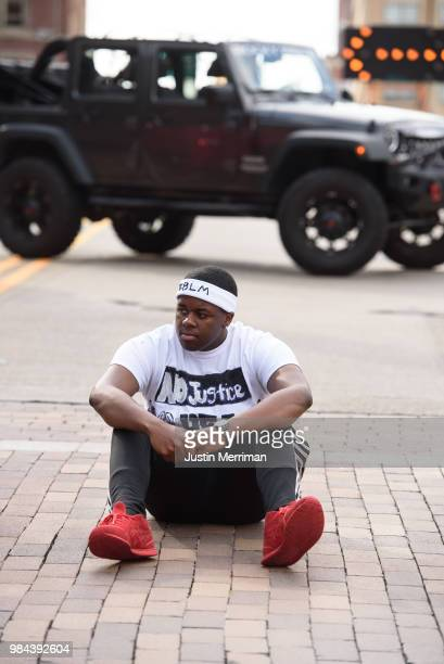 Marcus King of Turtle Creek sits in the street as he joins protestors to block a major downtown intersection a day after the funeral of Antwon Rose...