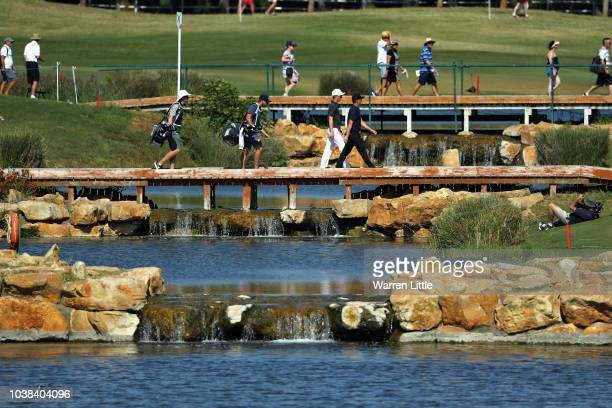 Marcus Kinhult of Sweden and Tom Lewis of England walk over a bridge on hole fourteen during Day Four of the Portugal Masters at Dom Pedro Victoria...