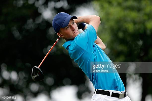 Marcus Kinhult of Sweden plays a shot during the Mixed Team on day ten of the Nanjing 2014 Summer Youth Olympic Games at at Zhongshan International...