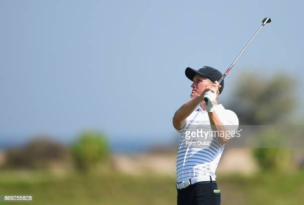 Marcus Kinhult of Sweden plays a shot on the 4th hole on Day Two of the NBO Golf Classic Grand Final European Challenge Tour at Al Mouj Golf on...