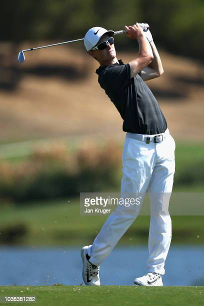 Marcus Kinhult of Sweden plays his second shot on hole eleven during Day Four of the Portugal Masters at Dom Pedro Victoria Golf Course on September...