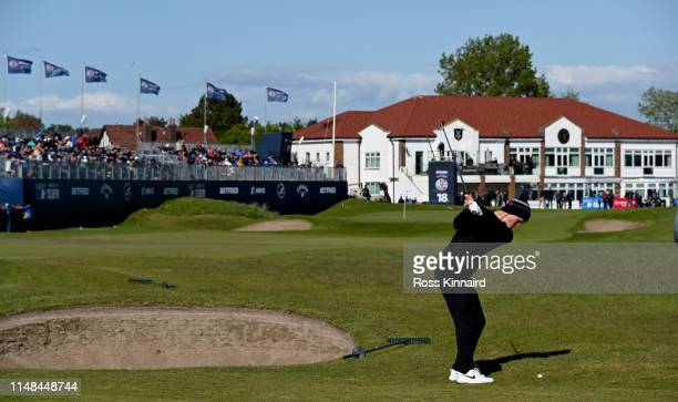 Marcus Kinhult of Sweden plays his second shot on the 18th hole with his caddie during day three of the Betfred British Masters at Hillside Golf Club...