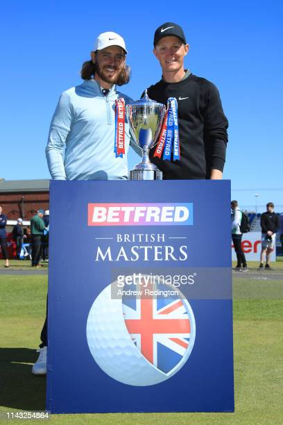 Marcus Kinhult of Sweden poses with the trophy and Tommy Fleetwood of England during day four of the Betfred British Masters at Hillside Golf Club on...