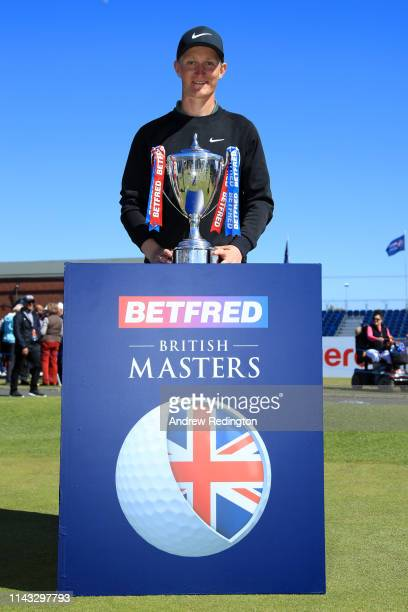 Marcus Kinhult of Sweden poses with the trophy during day four of the Betfred British Masters at Hillside Golf Club on May 12, 2019 in Southport,...