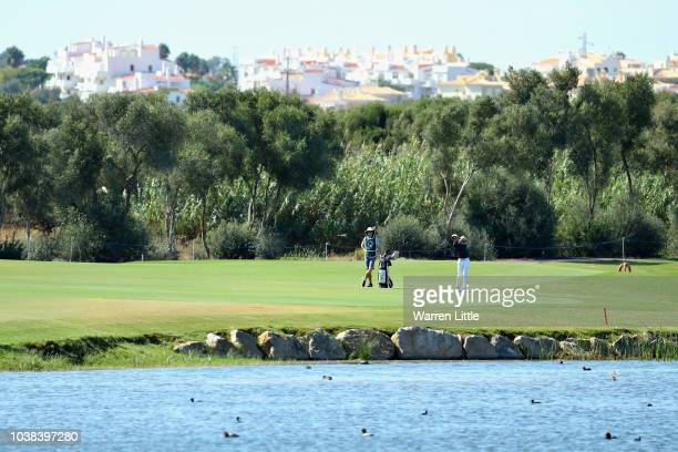 Marcus Kinhult of Sweden takes his second shot on hole twelve during Day Four of the Portugal Masters at Dom Pedro Victoria Golf Course on September...