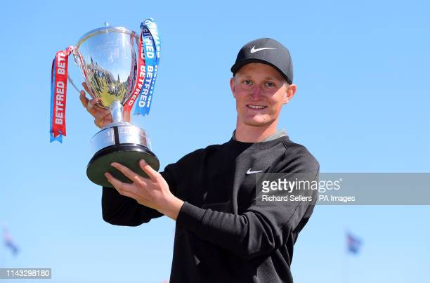 Marcus Kinhult with the trophy after winning the Betfred British Masters at Hillside Golf Club Southport