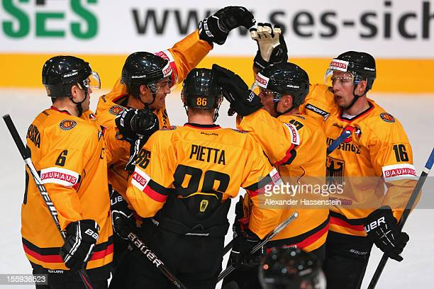 Marcus Kink of Germany celebrates scoring the fisrt goal with his team mates during the German Ice Hockey Cup 2012 first round match between Germany...