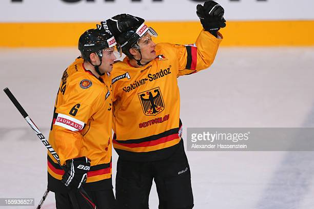 Marcus Kink of Germany celebrates scoring the fisrt goal with his team mate Florian Ondruschka during the German Ice Hockey Cup 2012 first round...