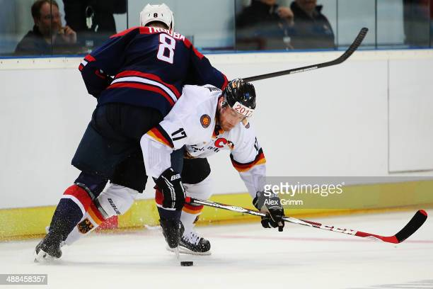 Marcus Kink of Germany is challenged by Jacob Trouba of USA during the international ice hockey friendly match between Germany and USA at Arena...
