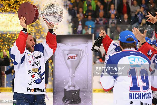 Marcus Kink team captain of Mannheim celebrates winning the German Championship title after winning the DEL Playoffs Final Game 6 between ERC...