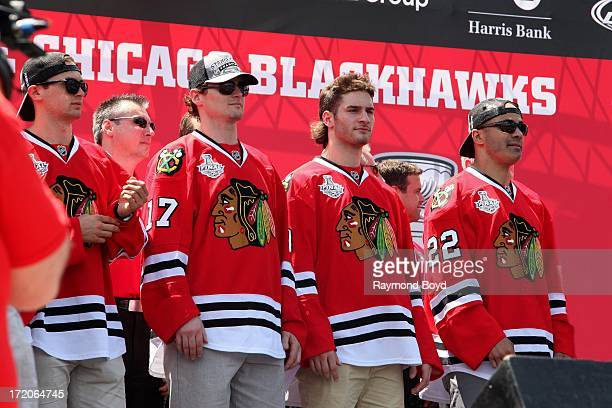 Marcus Kruger, forward for the Chicago Blackhawks, Sheldon Brookbank, defenseman for the Chicago Blackhawks and Brandon Saad and Jamal Mayers...