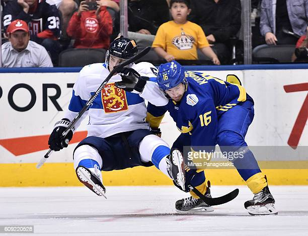 Marcus Kruger of Team Sweden knocks Valtteri Filppula of Team Finland to the ice during the World Cup of Hockey 2016 at Air Canada Centre on...