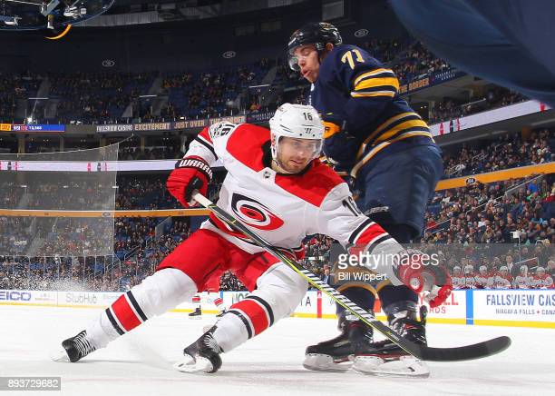 Marcus Kruger of the Carolina Hurricanes skates for the puck against Evan Rodrigues of the Buffalo Sabres during an NHL game on December 15 2017 at...
