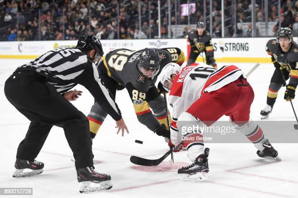 Marcus Kruger of the Carolina Hurricanes takes a faceoff against Alex Tuch of the Vegas Golden Knights during the game at TMobile Arena on December...