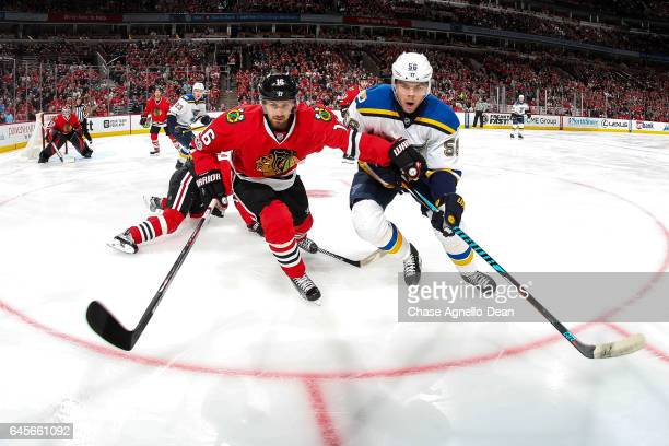Marcus Kruger of the Chicago Blackhawks and Magnus Paajarvi of the St Louis Blues watch for the puck in the first period at the United Center on...