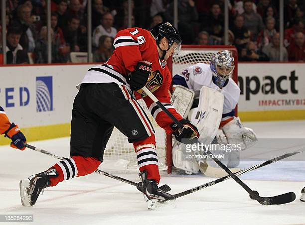 91b787af3 Marcus Kruger of the Chicago Blackhawks attempts a shot against Rick  DiPietro of the New York
