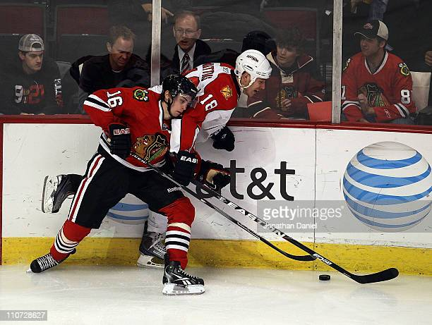 Marcus Kruger of the Chicago Blackhawks battles for the puck with Shawn Matthias of the Florida Panthers at the United Center on March 23 2011 in...